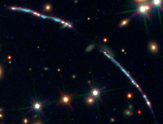 image showing a gravitational lensed galaxy cluster