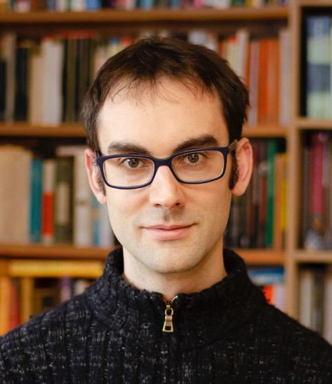 portrettbildet av en ung man med briller
