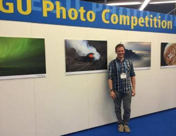 Morgan next to the winning areal photo of the Holuhraun volcanic eruption at Iceland in 2014. Photo: Morgan Jones and Sverre Planke, CEED