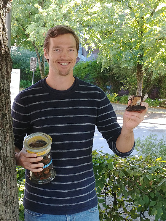 Christian Winther Wold holding a chaga sample