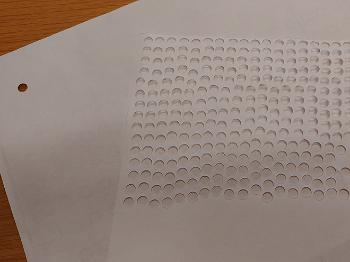 Sheets of paper with stamped holes