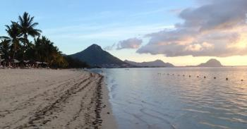 Typical view of Mauritius beachfront with volcanic mountains in background. The basaltic lavas constituting these mountains formed no older than 9 million years ago. Photo; Susan J. Webb, Prof., University of the Witwatersrand
