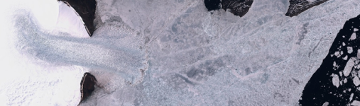 Figure 1: The a glacier surge from Vavilov ice cap advances into the sea and breaks the melting sea-ice (Severnaya Zemlya), the image is taken by the Sentinel-2 satellite. Image: Project team