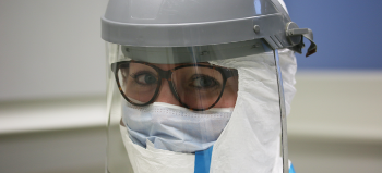 person in protected lab-ware, illustration.