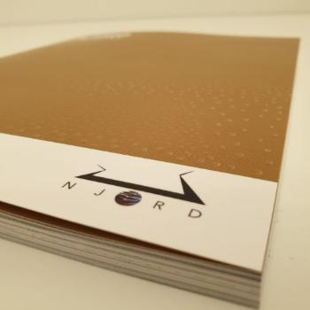 Close-up of Njord-logo on a booklet.