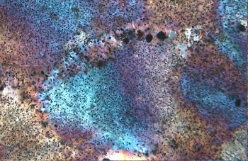 Microscopic image of rock with colours in turquoise, purple and brown.