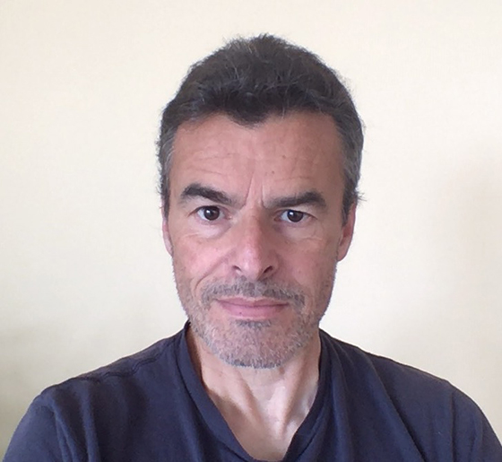Middle-aged man with dark hair and blue t-shirt