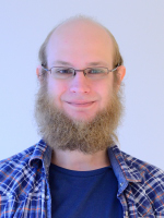 Image may contain: Glasses, Hair, Facial hair, Beard, Face.